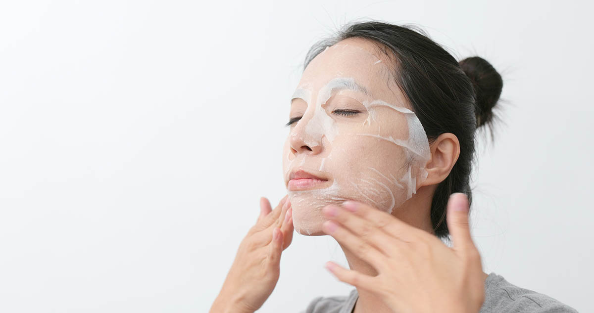 Woman apply chemical peel mask skin care