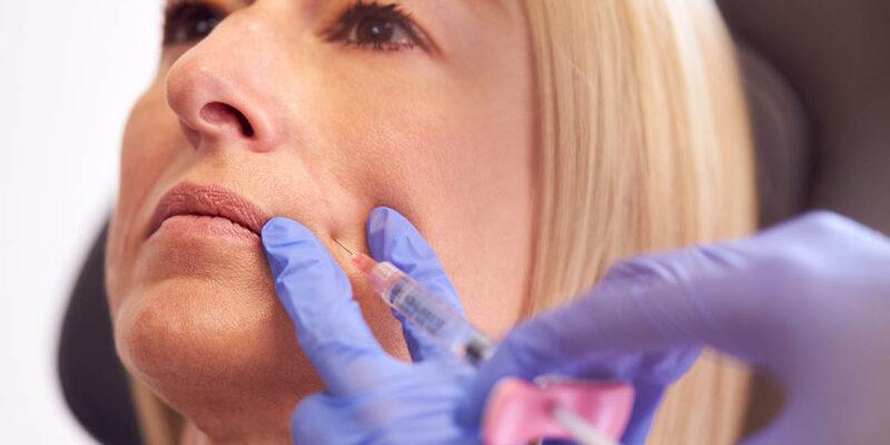 close up of mature woman receiving sunekos treatment