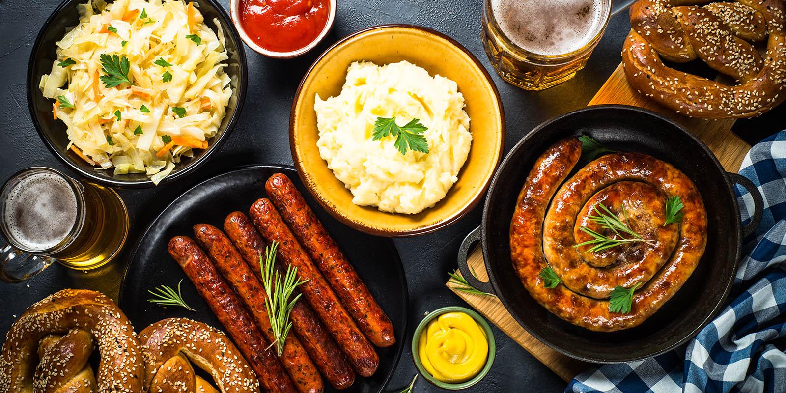 Oktoberfest food - sausage, beer and bretzel.