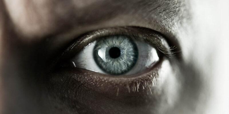 close up of male eye and eye bag