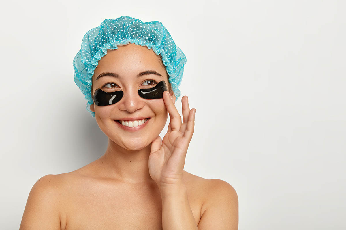 asian woman with mask for eye bags