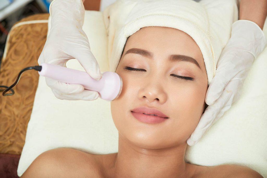 Woman having HIFU Ultrasound eye bag removal treatment in Singapore